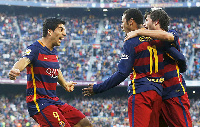 Barcelona's Luis Suarez (left), Neymar (centre) and Sergi Roberto celebrate a goal against Villarreal during their La Liga match at Camp Nou stadium in Barcelona on Sunday