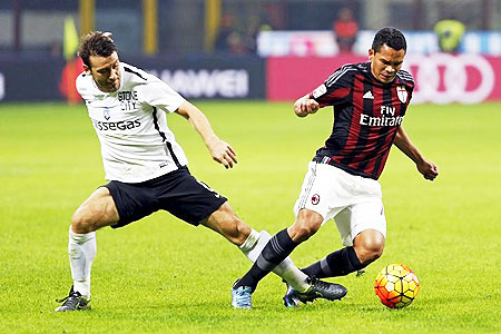 AC Milan's Carlos Bacca (right) is challenged by Atalanta's Gianpaolo Bellini during their Serie A match at the San Siro stadium in Milan on Saturday