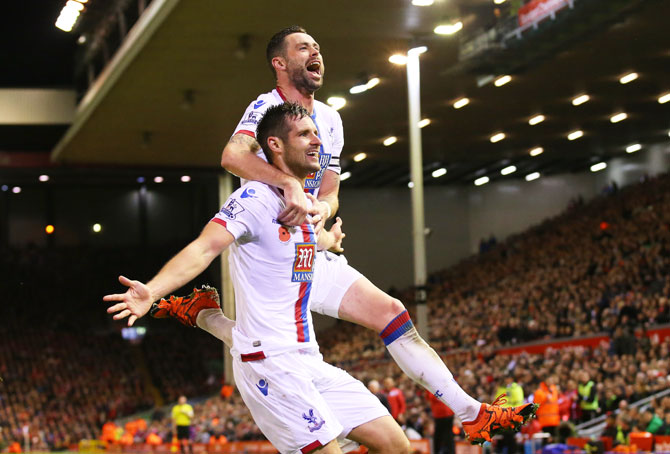 Crystal Palace's Scott Dann (left) celebrates with teammate Damien Delaney after scoring his side's second goal against Liverpool during their Barclays English Premier League match at Anfield in Liverpool on Sunday