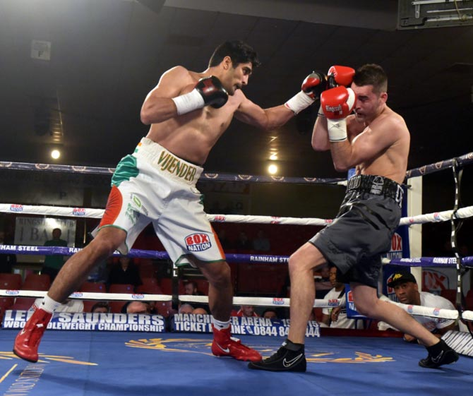 Vijender Singh (left) in action against Dean Gillen during their middleweight bout