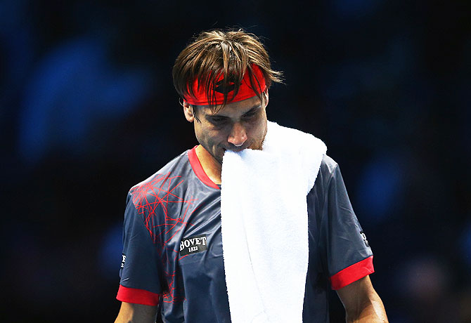 Spain's David Ferrer reacts after losing a point