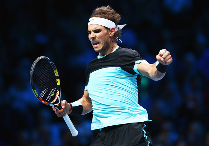 Spain's Rafael Nadal celebrates a point in his men's singles match against Switzerland's Stanislas Wawrinka on Day 2 of the Barclays ATP World Tour Finals at O2 Arena in London on Monday