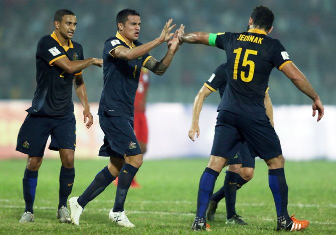 Australia Socceroos' Tim Cahill celebrates with teammate Mile Jedinak after scoring against Bangladesh during their 2018 FIFA World Cup qualification match at Bangabandhu National Stadium in Dhaka on Tuesday