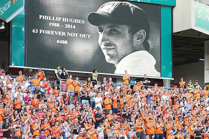 The crowd clapped at the 63rd minute of an A-League match between Brisbane Roar and Perth Glory at Suncorp Stadium in Brisbane as a tribute to Australian Cricketer Phillip Hughes