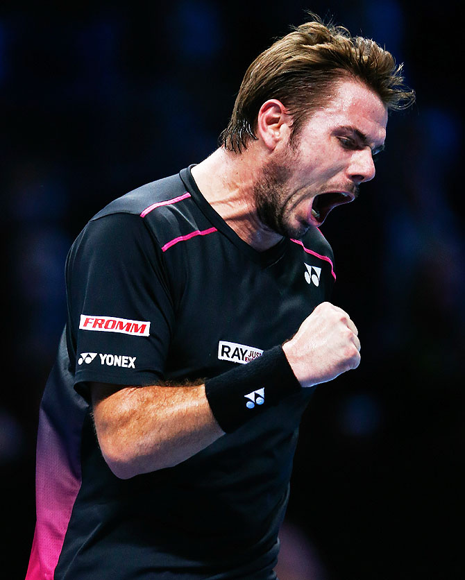 Switzerland's Stanislas Wawrinka celebrates a point in his men's singles match against Spain's David Ferrer on Day 4 of the ATP World Tour Finals at the O2 Arena in London on Wednesday