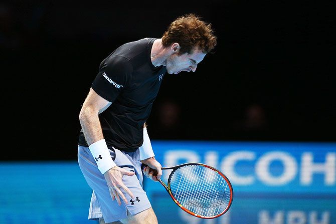 Great Britain's Andy Murray reacts in frustration during his match against Switzerland's Stanislas Wawrinka