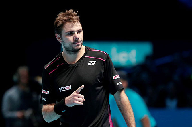 Switzerland's Stanislas Wawrinka celebrates during his match against Great Britain's Andy Murray in their round-robin match at the 02 Arena in London on Friday