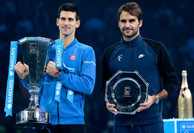 Serbia's Novak Djokovic and Switzerland's Roger Federer pose with their trophies after their match