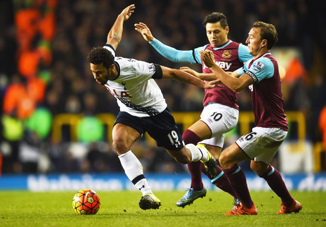 Tottenham Hotspur's Mousa Dembele goes past West Ham United's Mauro Zarate and Mark Noble