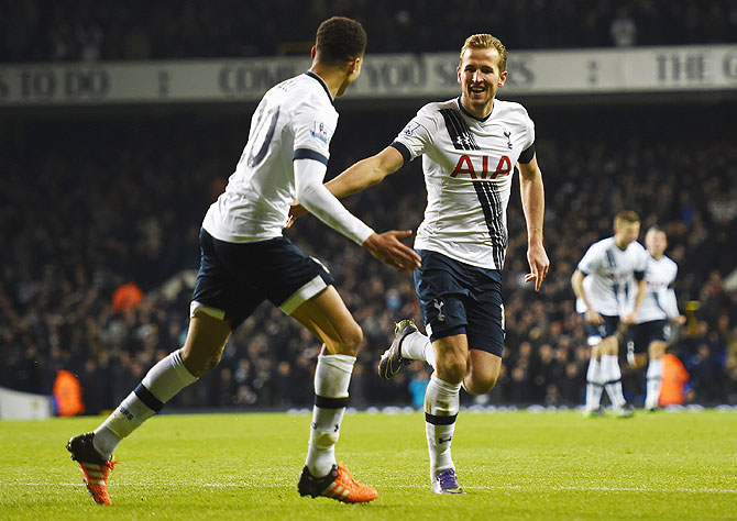 Tottenham Hotspur's Harry Kane celebrates scoring his team's third goal against West Ham United during their Barclays Premier League match at White Hart Lane in London on Sunday