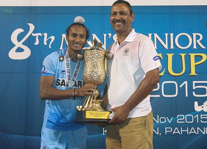 India skipper Harjeet Singh ad coach Harendra Singh with the junior Asia Cup hockey trophy