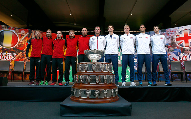 The Davis Cup teams of Belgium and Great Britain pose ahead of the final