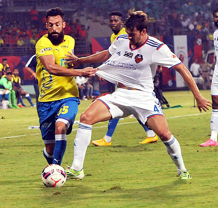 Players from Kerala Blasters FC and FC Goa vie for possession during the Indian Super League Match at Jawaharlal Nehru Stadium in Kochi on Sunday