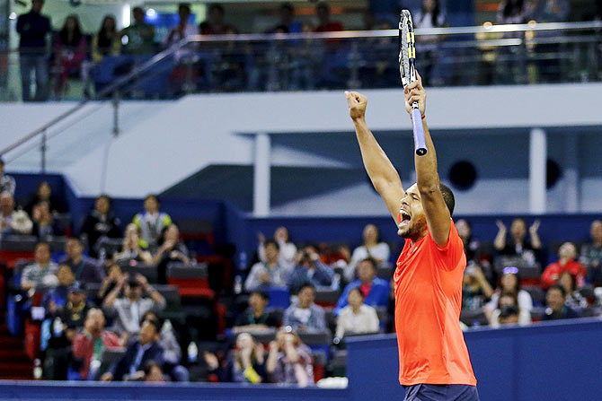 Jo-Wilfried Tsonga of France celebrates after beating Rafael Nadal of Spain in their men's singles semi-final match