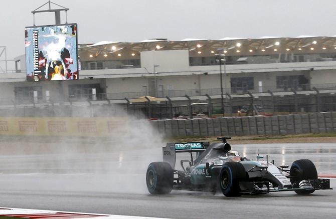 US Grand Prix: Hamilton fastest as fans shut out by rain