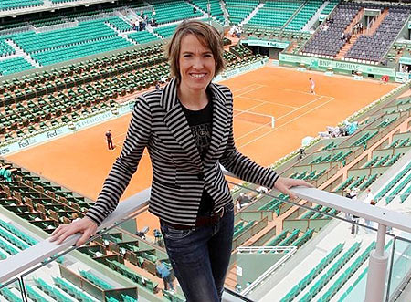 Former Belgian tennis player Justine Henin poses on top roof of the Philippe Chartrier court at the Roland Garros stadium in Paris
