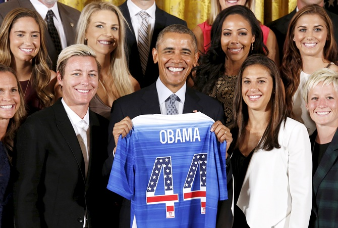 US President Barack Obama holds a jersey given to him during an event honoring the United States women's soccer team