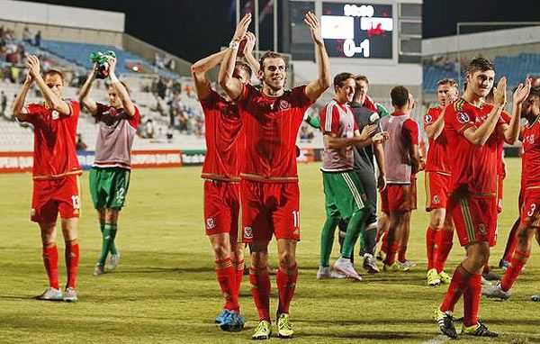 Wales' Gareth Bale and teammates celebrate at the end of the match against Cyprus at GSP Stadium, Nicosia, in Cyprus