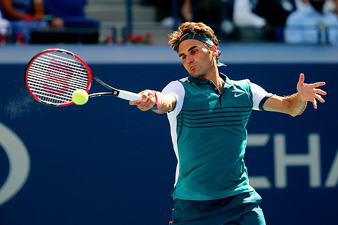 Switzerland's Roger Federer returns a shot to Germany's Philipp Kohlschreiber during their men's singles third round match of the 2015 US Open at the USTA Billie Jean King National Tennis Center in Flushing meadows in New York City on Saturday