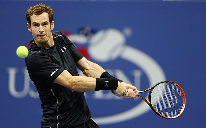Great Britain's Andy Murray plays a backhand against Brazil's Thomaz Bellucci