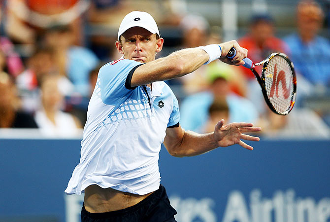 South Africa's Kevin Anderson returns a shot to Great Britain's Andy Murray