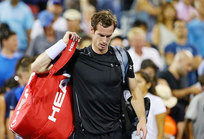 Great Britain's Andy Murray leaves the court after losing to South Africa's Kevin Anderson in the fourth round of the US Open tennis tournament at USTA Billie Jean King National Tennis Center in New York on Monday