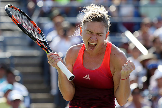 Romania'S Simona Halep celebrates after defeating Germany'S Sabine Lisicki during their fourth round match of the US Open on Monday