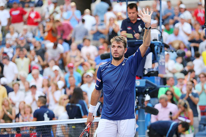 Switzerland's Stanislas Wawrinka celebrates his win against USA's Donald Young