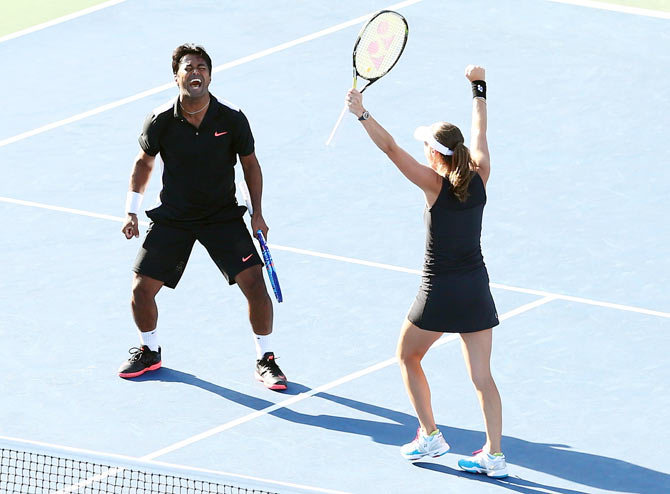 Switzerland's Martina Hingis and India's Leander Paes celebrate after defeating USA's Bethanie Mattek-Sands and Sam Querrey to win the US Open mixed doubles title on Friday