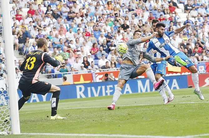 Real Madrid's Cristiano Ronaldo (centre) gets into a scramble with Espanyol's Ruben Duarte (right) and Pau Lopez (left) before scoring
