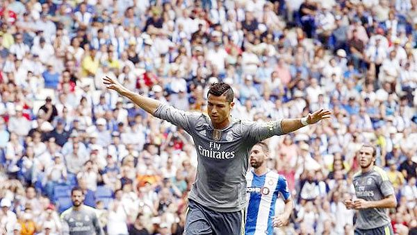 Real Madrid's Cristiano Ronaldo celebrates a goal against Espanyol during their La Liga match in Cornella, near Barcelona, on Saturday