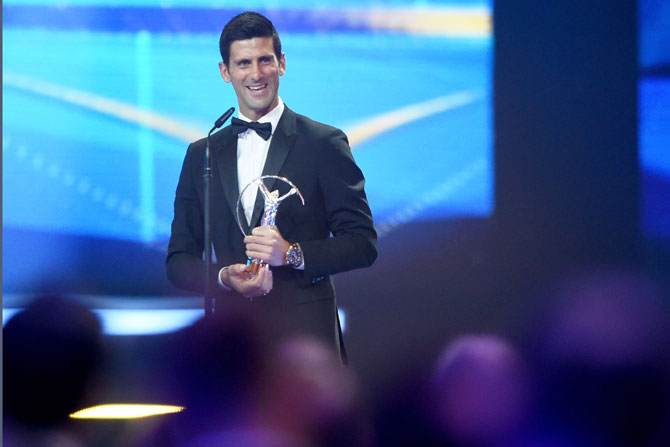 Tennis player Novak Djokovic of Serbia accepts his Laureus World Sportsman of the Year trophy