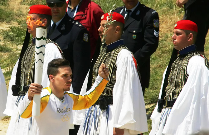 The first torchbearer and reigning world champion gymnast Lefteris Petrounias runs with the torch during the lighting ceremony of the Olympic Flame for the Rio Olympic Games on April 21, 2016 in Olympia, Greece. Torchbearers will carry the Olympic Flame from Ancient Olympia on relay through Greece for eight days before a hand-over ceremony at Panathenian Stadium in Athens