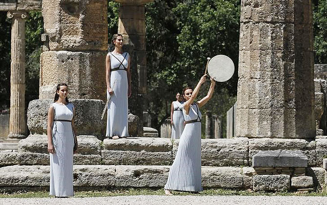 Priestesses attend the Olympic flame lighting ceremony for the Rio 2016 Olympic Games inside the ancient Olympic Stadium on the site of ancient Olympia, Greece, on Thursday