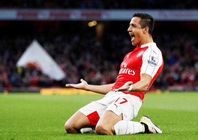 Arsenal's Alexis Sanchez celebrates scoring their first goal against West Bromwich Albion during their English Premier League match at Emirates Stadium in London on Thursday