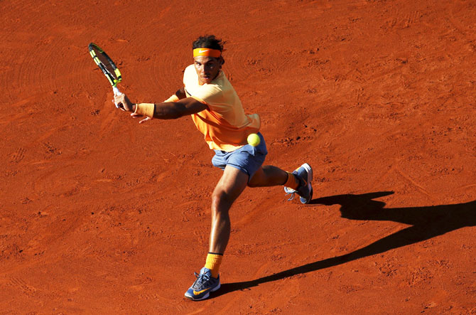 Spain's Rafael Nadal returns a ball to Japan's Kei Nishikori during the Barcelona Open tennis tournament final on Sunday