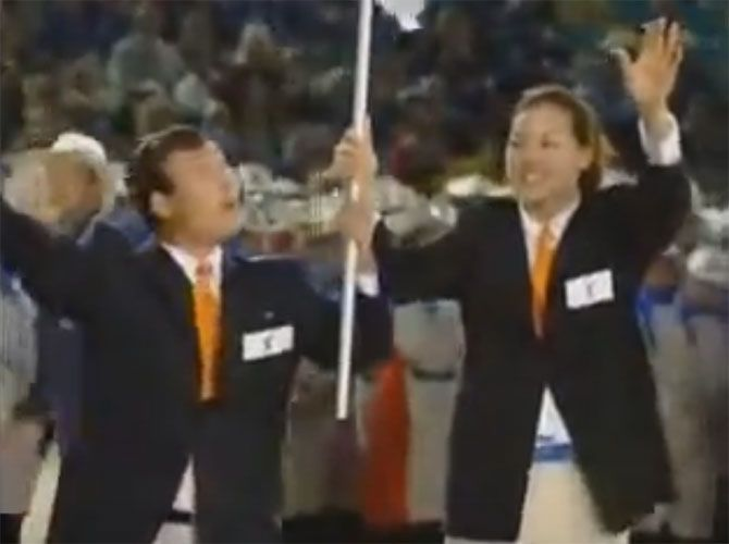 South Korean basketballer Chung Un Soon, right, and North Korean judo coach Park Chong Chul were joint flag-bearer at the 2000 Olympic Games