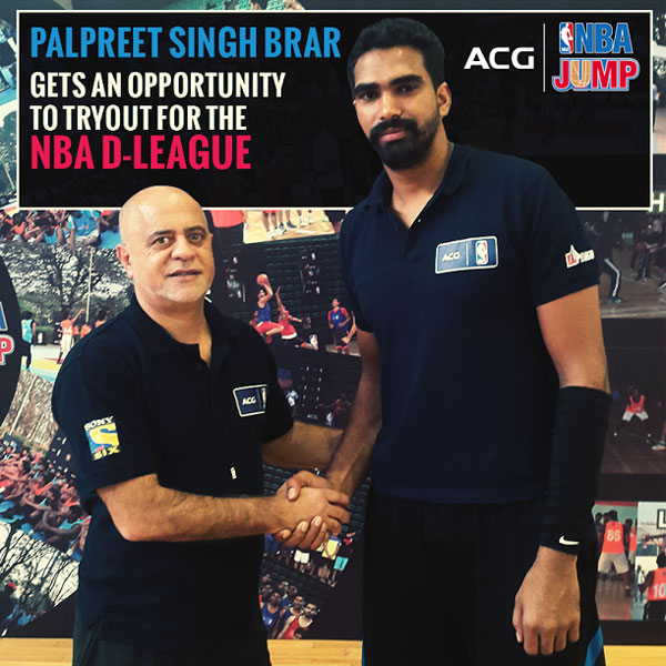 Palpreet Singh is congratulated by Carlos Barroca, NBA India, VP after winning the AGC-NBA national camp