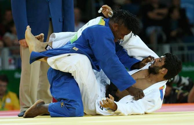 India's Avtar Singh, in white, is at the receiving end from Misenga Popole of the Refugee Olympic Team in the men's judo 90kg elimination Round of 32 at the Rio Olympics on Wednesday