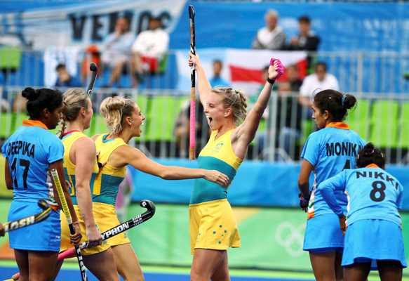 Australia's Jane Claxton, centre, celebrates with her teammates after scoring against India in the women's Pool B hockey match at the Rio Olympics on Wednesday