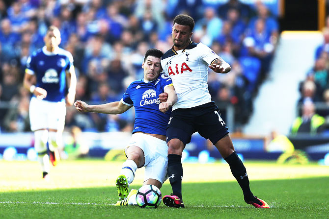 Gareth Barry of Everton battle for possession with Kyle Walker of Tottenham Hotspur during the Premier League match at Goodison Park in Liverpool on Saturday