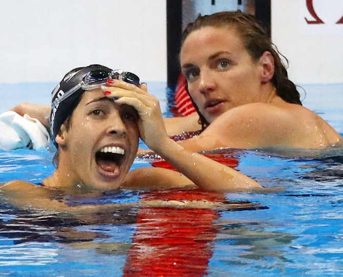Madeline DiRado, right, of the United States celebrates winning gold in the women's 200m backstroke final on Day 7