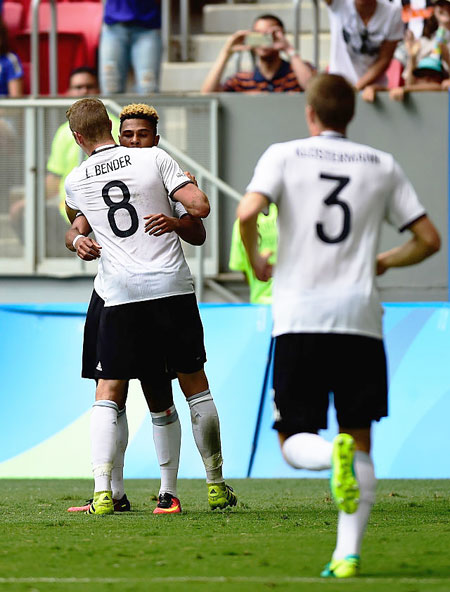 Germany's Serge Gnabry #17 celebrates with teammate Lars Bender #8 after scoring against Portugal in the first half during the Men's Football quarter-final match on Day 8 of the Rio 2016 Olympic Games at Mane Garrincha Stadium in Brasilia on Saturday