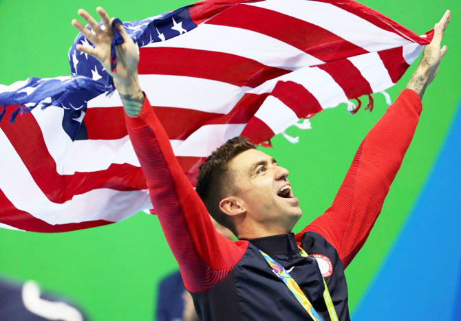 Anthony Ervin of USA celebrates his gold medal win in the Men's 50m Freestyle swimming event at the Olympic Aquatics Stadium on Friday