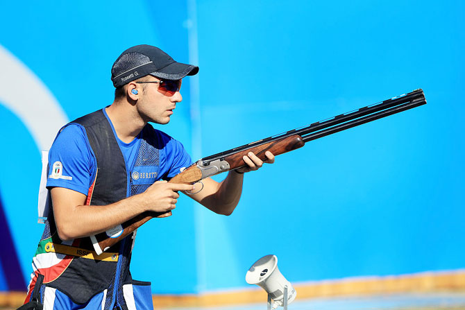 Gabriele Rossetti of Italy competes in the skeet finals match on at the Olympic Shooting Centre on Saturday
