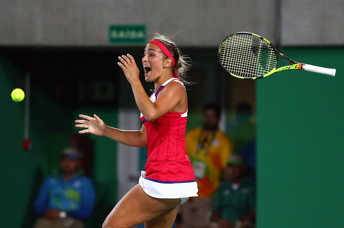 Puerto Rico's Monica Puig celebrates after winning the women's Singles Gold Medal Match at the Rio 2016 Olympic Games on August 14