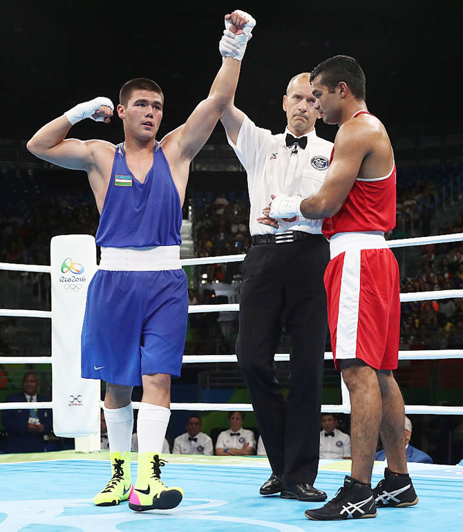 Uzbekistan's Bektemir Melikuziev celebrates winning his bout against India's Vikas Krishan in the men's middleweight 75kg fight at Riocentro in Rio de Janeiro on Monday