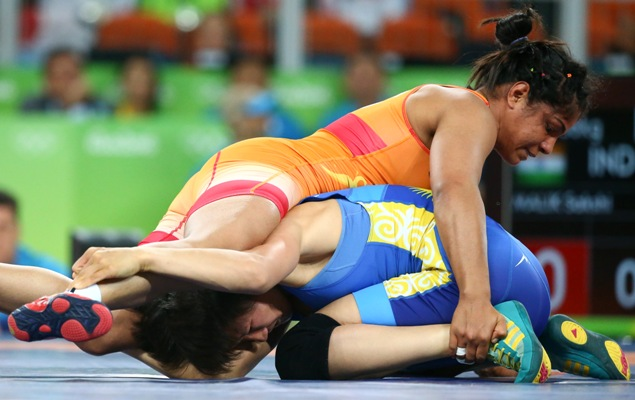 India's Sakshi Malik pins down Aisuluu Tynybekova of Kyrgyzstan in the 58kg freestyle bronze medal play-off at the Rio Olympics.