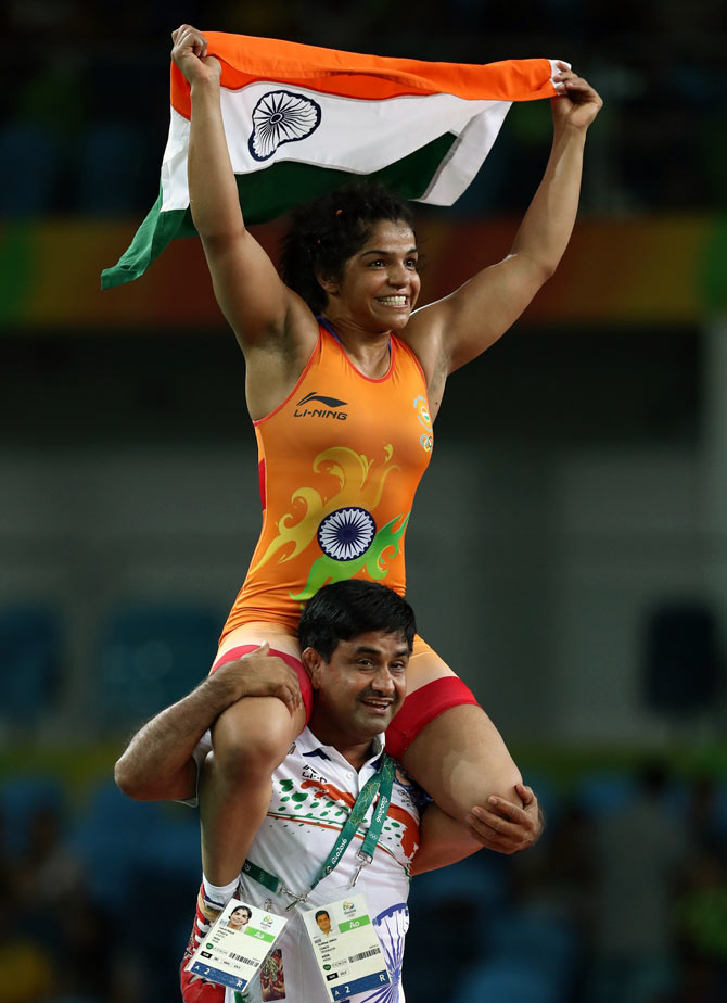 Sakshi Malik celebrates with her coach Kuldeep Malik after winning bronze medal in the women's Freestyle 58 kg Bronze match on Day 12 of the Rio 2016 Olympic Games. Photograph: Lars Baron/Getty Images