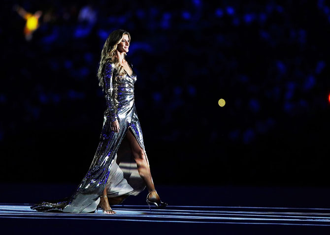 Brazilian supermodel Gisele Bundchen walks as The Girl From Ipanema during the Bossa segment of the Opening Ceremony of the Rio 2016 Olympic Games at Maracana Stadium at Rio de Janeiro on August 5